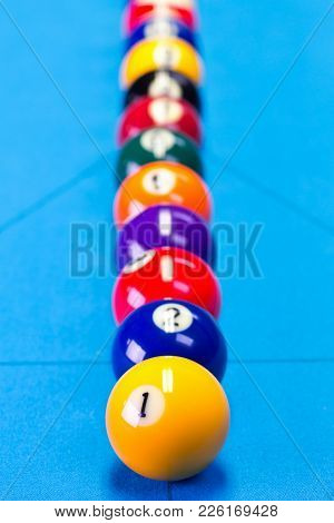 Billiard Pool Game Balls Lined Up On Billiard Table With Blue Cloth, Selective Focus