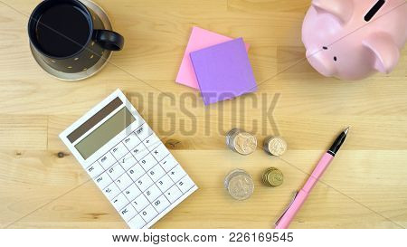 Modern Office Desk Overhead With Calculator, Piggy Bank And Cash, Overhead.