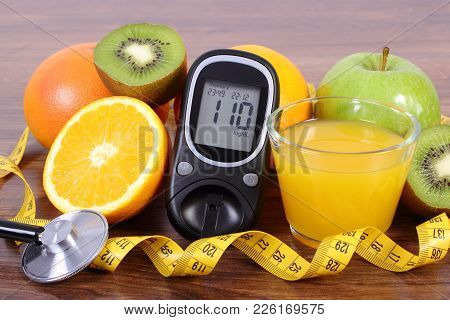 Glucose Meter With Result Of Sugar Level, Medical Stethoscope, Fresh Ripe Fruits, Glass Of Juice And