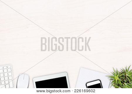 White Wooden Office Desk Top View With Computer Keyboard, Tablet Pc, Smartphone, Notepad And Plant W