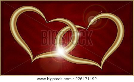 Two Golden Hearts On Red Velvet Into A Box With Gold Frame