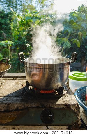 Hot Steam From A Cooking Pot On A Gas Stove In The Kitchen.
