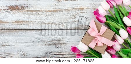 Overhead View Of A Springtime Pink Tulips On White Weathered Wooden Boards