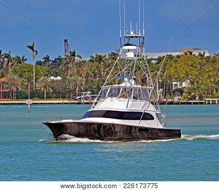 Sports Fishing Boat Cruising The Florida Intra-coastal Off Miami Beach.
