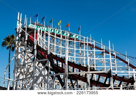 San Diego, California - February 9, 2018:  People Ride The Iconic Giant Dipper Roller Coaster, A Woo