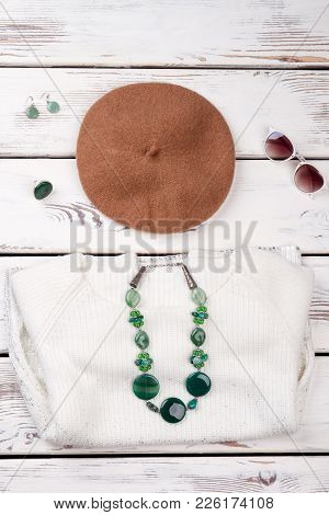 Flat Lay Women Clothes And Accessories. Female Beret, Sweater, Stone Jewelry And Sunglasses. Ladies