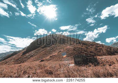 Forsaken Cabin In Mountains