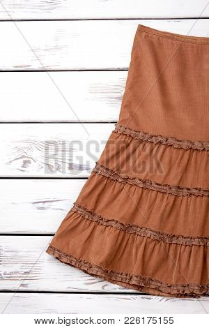 Female Vintage Apparel, Copy Space. Brown Skirt Of Vintage Style On White Wooden Background, Cropped