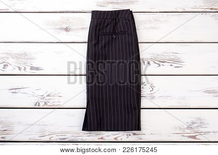 Female Formal Style Skirt. Women Black Striped Skirt For Office Work, White Wooden Background. Ladie