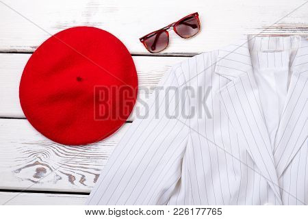 Close Up Female Fashion Clothes And Accessories. Women French Beret, White Jacket And Sunglasses. Fl