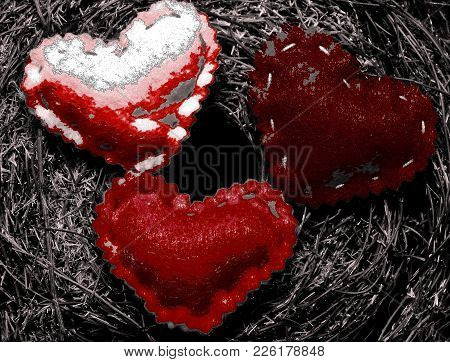 A Abstract Shot Of Three Semi Red Hearts On A Dark Mossy Background