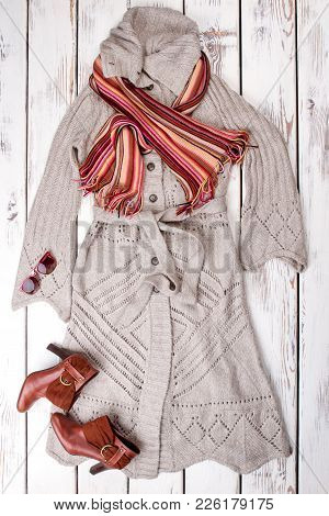 Set Of Women Stylish Garment, Top View. Female Modern Cardigan With Brown Scarf, Boots And Sunglasse