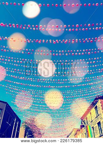 Festive Street In Gay Neighborhood Decorated With Pink Balls, With Bokeh Light Effect. Annual Summer