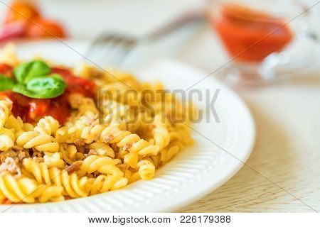 Close-up Of Traditional Italian Spaghetti Or Fusilli With Bolognese Sauce On Wooden Background