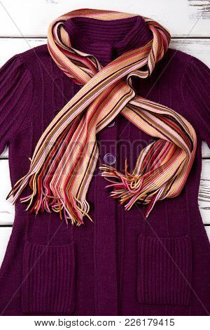 Women Fashion Cardigan And Scarf. Set Of Female Autumn Apparel On Light Wooden Background. Feminine