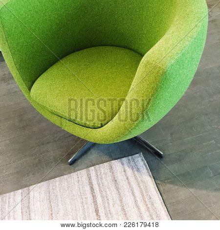 Trendy Green Armchair On Dark Wooden Floor. Modern Furniture.