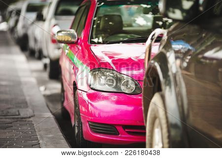 Pink Car In The Parking Lot. Taxi Service Colorful. Recognition Of Road Transport.