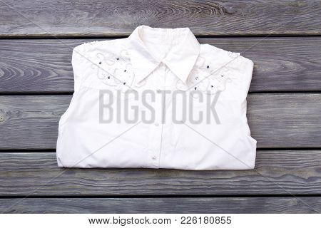 Female Beautiful Shirt, Wooden Background. New Elegant Shirt With Rhinstones For Women. Boutique Of