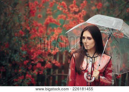 Beautiful Woman With Transparent Raincoat And Umbrella Enjoying Rain