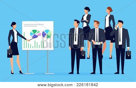 Presentation. Businesswoman Makes A Presentation In Front Of A Group Of People. Businessmen In A Fla