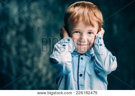 Five year old boy smiling at camera. Childhood. Kid's fashion.