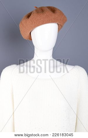 Close Up Female Mannequin Ir French Beret. Portrait Of Dummy Dressed In Brown Headgear And White Kni