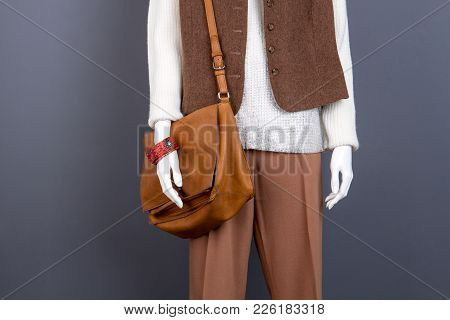 Female Mannequin With Fashion Accessories. Ladies Classy Trousers, Waistcoat And Sweater. Beautiful