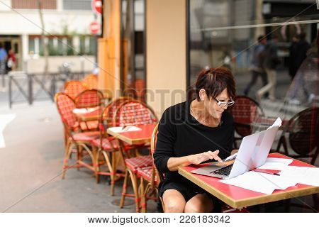 Using Laptop Aged Tired Woman Bank Employee Writing Financial Plan For Several Hours. Lady Hold Repo