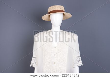 Woven Hat And Silk Blouse On Mannequin. Classy Clothes On Female Mannequin, Studio Shot. Store Of La