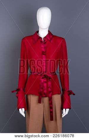 Mannequin Dressed In Classy Women Apparel. Red Beautiful Blouse And Classic Trousers On Female Manne