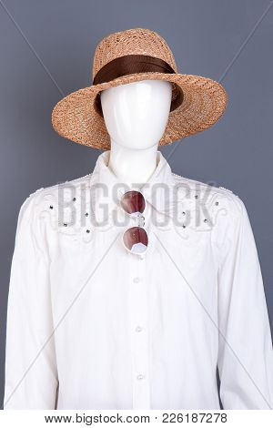 Straw Hat And Fashion Design Female Blouse. Female Mannequin Wearing White Shirt, Sunglasses And Wov