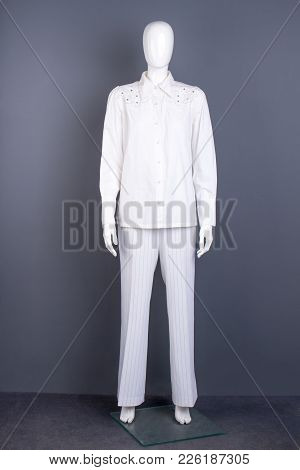 Full Length Mannequin In White Apparel. Women Long Sleeve Blouse And Trousers On Mannequin. Female G
