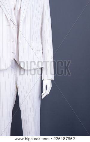 Women Business Style Costume On Mannequin. Elegant White Blazer, Waistcoat And Trousers For Business