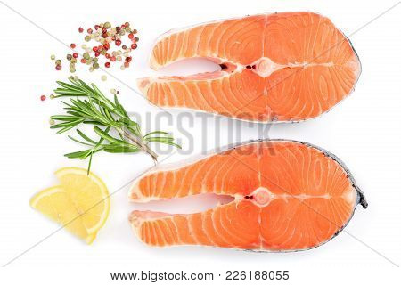 Slice Of Red Fish Salmon With Lemon, Rosemary And Peppercorns Isolated On White Background. Top View