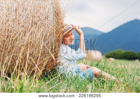 Boy Sit On The Field Under The Hay Roll - Careless Summet In Country Side