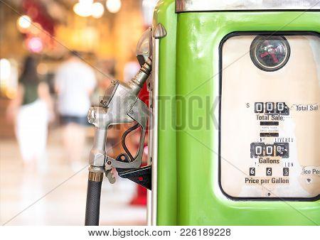 Ancient Petrol Oil Pump Dispenser On Blurred Bokeh Background