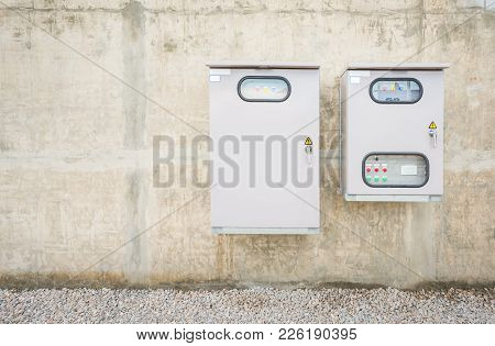 Electric Control Box On Concrete Wall At Factory