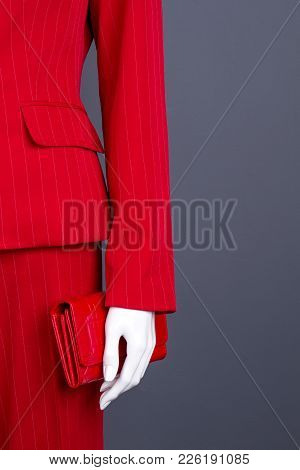 Women Red Classy Apparel And Wallet. Female Mannequin With Red Blazer, Trousers And Purse, Copy Spac