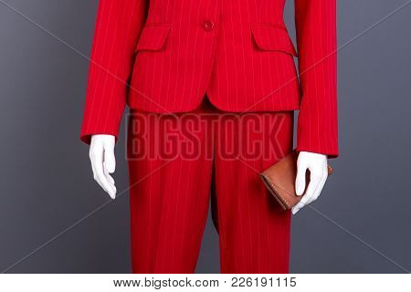 Female Elegant Suit And Leather Wallet. Manneqin In Female Red Blazer And Pants, Cropped Image. Fash