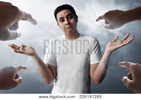 Asian Man Accused Expression On Smoke Background