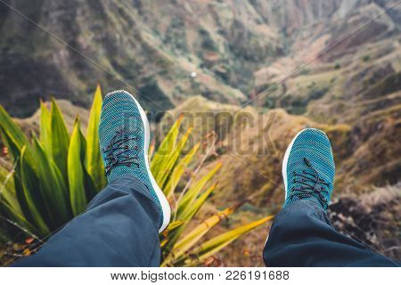 Feet Of Traveler Streching Down His Legs Over Breathtaking Mountain Landscape With Mountain Peaks, R