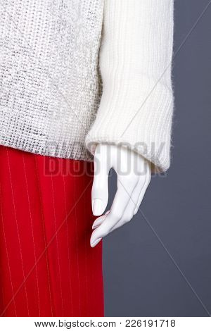 Close Up Female Warm Sweater On Mannequin. Red Trousers And White Soft Pullover For Women. Store Of