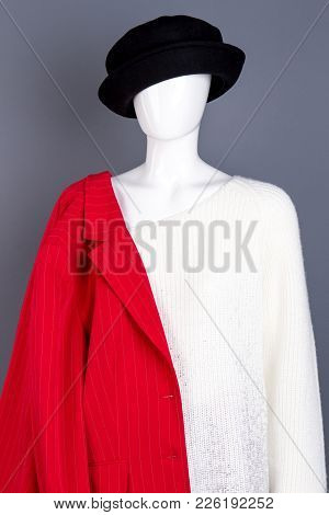 Mannequin Dressed In Women Classy Garment. Black Hat, White Sweater And Red Blazer On Female Mannequ