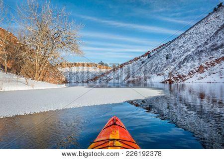 winter kayak paddling on Horsetooth Reservoir near Fort Collins in northern Colorado