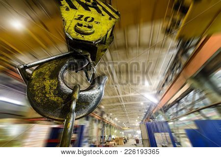 Powerful Hook Crane Close-up. Against The Background Of The Industrial Plant. Abstract Industrial Ba