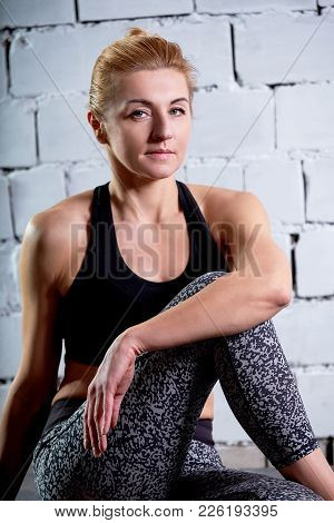 Young Woman Blonde Sits Look In Camera After Training Fitness. Close-up Portrait Sportsgirl Photos.
