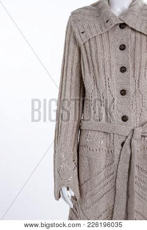 Grey Knitted Female Cardigan, Copy Space. Female Mannequin Dressed In Long Pullover With A Beautiful