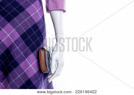 Close Up Mannequin In Purple Patterned Skirt. Female Mannequin With Modern Skirt And Wallet Close Up