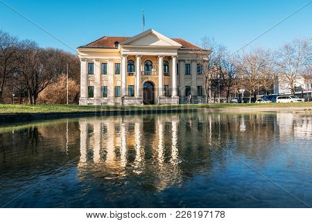 Munich, Germany - December 7, 2017: Prinz Carl Palais With Reflection In Pond In Evening In Munich,
