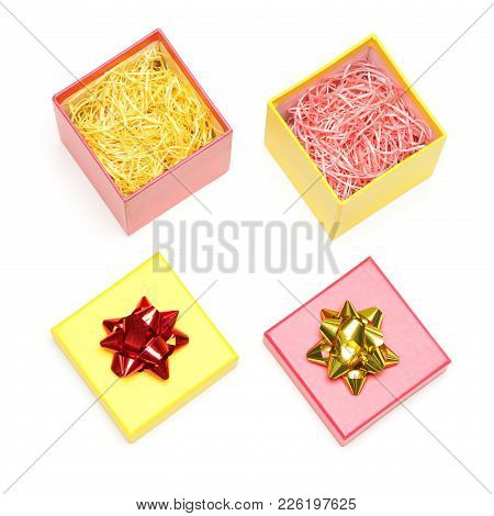 Two Open Colored Gift Boxes Filled With Decorative Shavings On White Background. Preparation For The